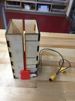 Using the Light sensor and a laser cut box, this student used an internal slider to create a melody. As the slider moves up and down, it moves closer and farther away from the sensor, creating a range of notes.